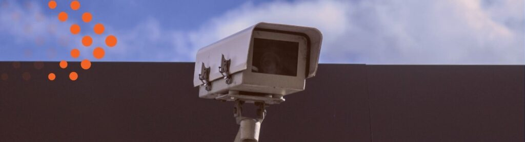 image of security camera with blue sky and clouds above, cyber security concept