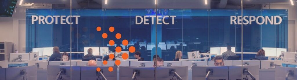 image of cyber security office with words protect, detect, respond on the wall