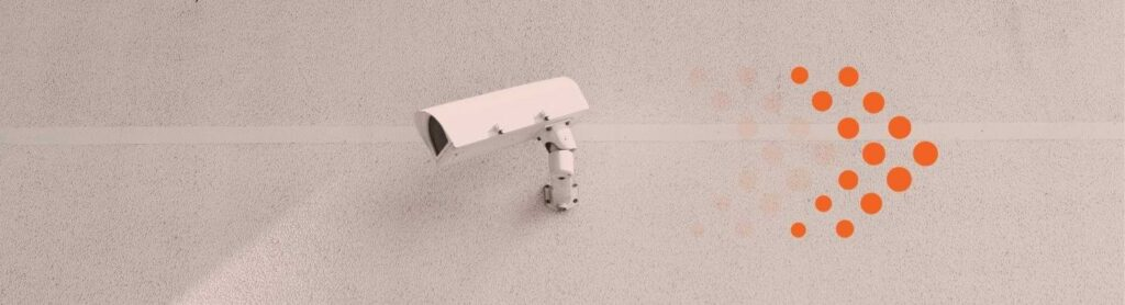image of white security camera on stark white wall