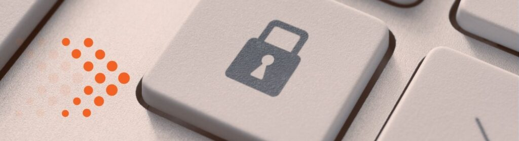 image of key on keyboard that has a padlock on it - cyber security